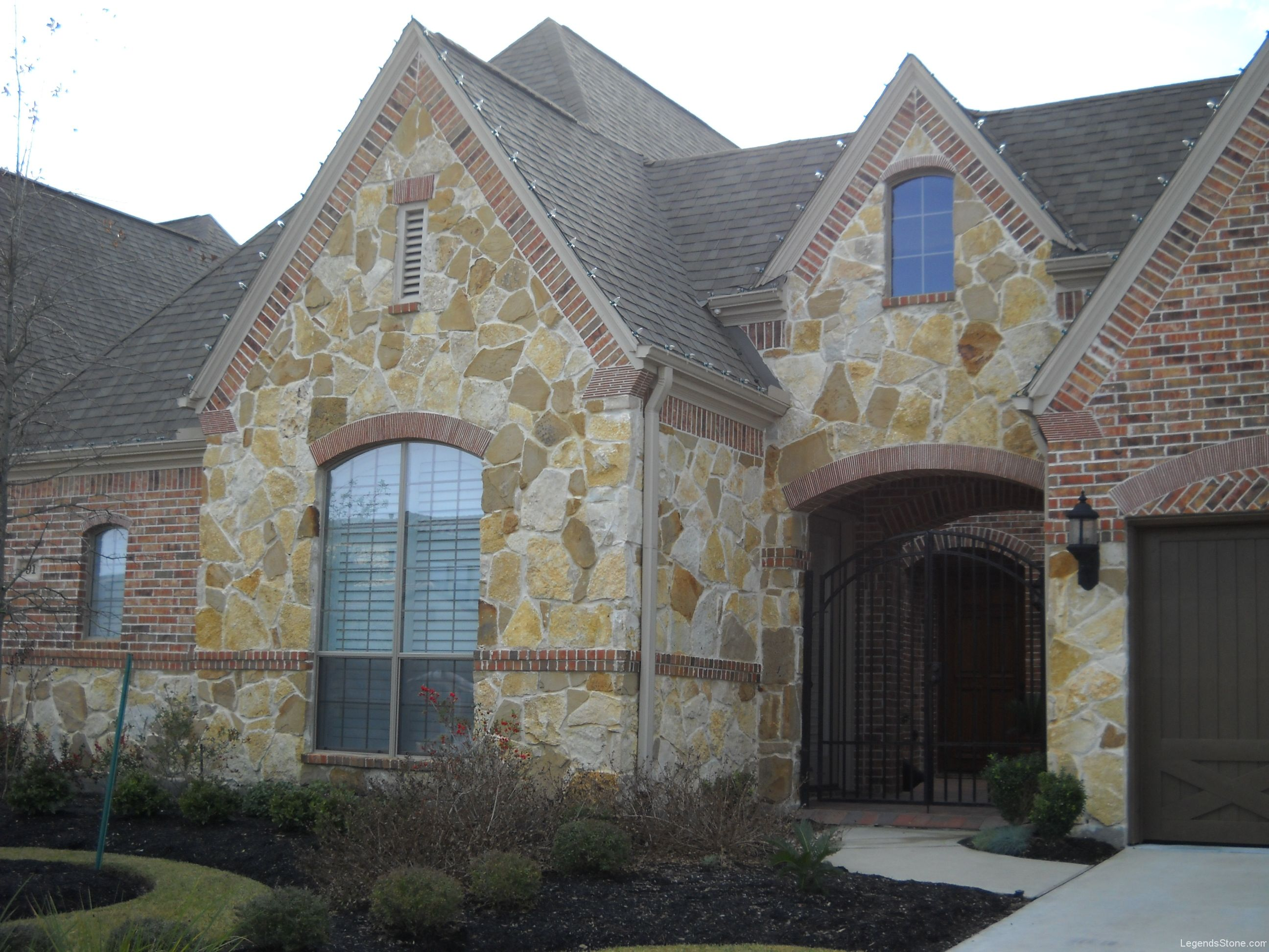 Stone And Red Brick Exterior
